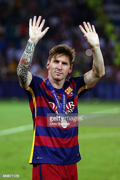 Lionel Messi of Barcelona celebrates with his winners medal after victory in the UEFA Super Cup between Barcelona and Sevilla FC at Dinamo Arena on...