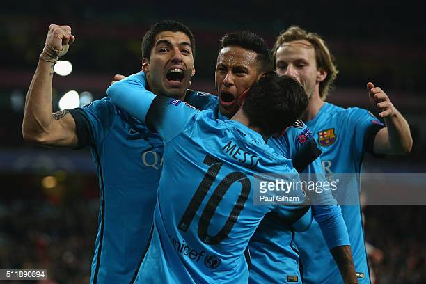 Lionel Messi of Barcelona celebrates with Luis Suarez and Neymar of Barcelona after scoring the first goal during the UEFA Champions League round of...