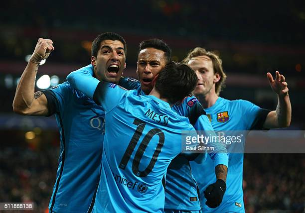 Lionel Messi of Barcelona celebrates with team mates after scoring the opening goal during the UEFA Champions League round of 16 first leg match...