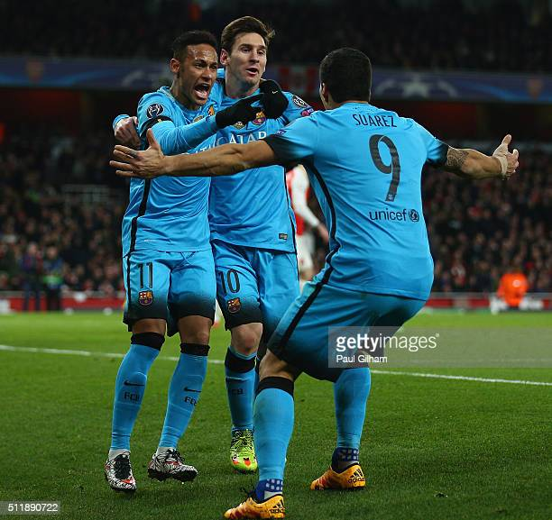 Lionel Messi of Barcelona celebrates with team mates after scoring the first goal during the UEFA Champions League round of 16 first leg match...
