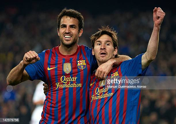 Lionel Messi of Barcelona celebrates with teammate Cesc Fabregas after scoring the opening goal during the UEFA Champions League quarterfinal second...