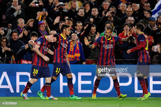 Lionel Messi of Barcelona celebrates with teammates Neymar Daniel Alves and Jordi Alba after scoring the opening goal during the UEFA Champions...
