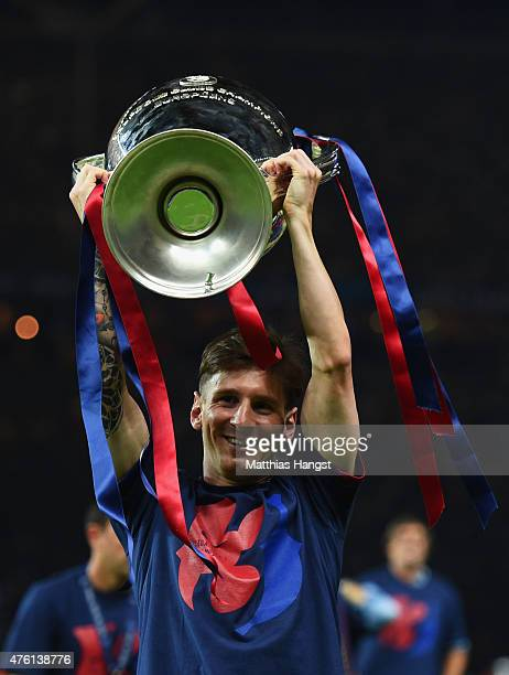 Lionel Messi of Barcelona celebrates with the trophy after the UEFA Champions League Final between Juventus and FC Barcelona at Olympiastadion on...