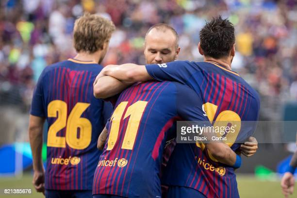 Lionel Messi of Barcelona comes over to congratulate Neymar of Barcelona on his second goal of the match during the International Champions Cup match...