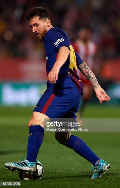 Lionel Messi of Barcelona controls the ball during the La Liga match between Girona and Barcelona at Municipal de Montilivi Stadium on September 23...