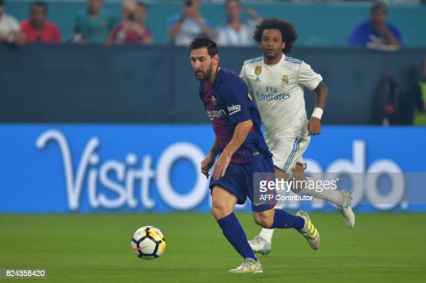 Lionel Messi of Barcelona controls the ball during their International Champions Cup football match at Hard Rock Stadium on July 29 2017 in Miami...