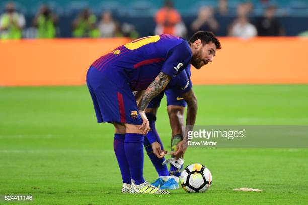 Lionel Messi of Barcelona discuses freekick tactics with Neymar Jr of Barcelona during the International Champions Cup match between Barcelona and...