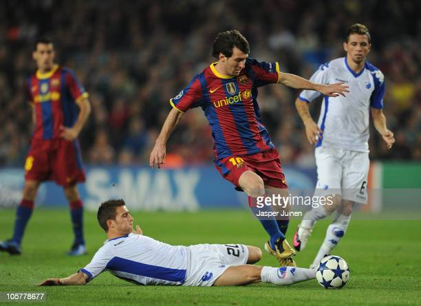 Lionel Messi of Barcelona duels for the ball with Martin Vingaard of FC Copenhagen as Claudemir looks on during the UEFA Champions League group D...