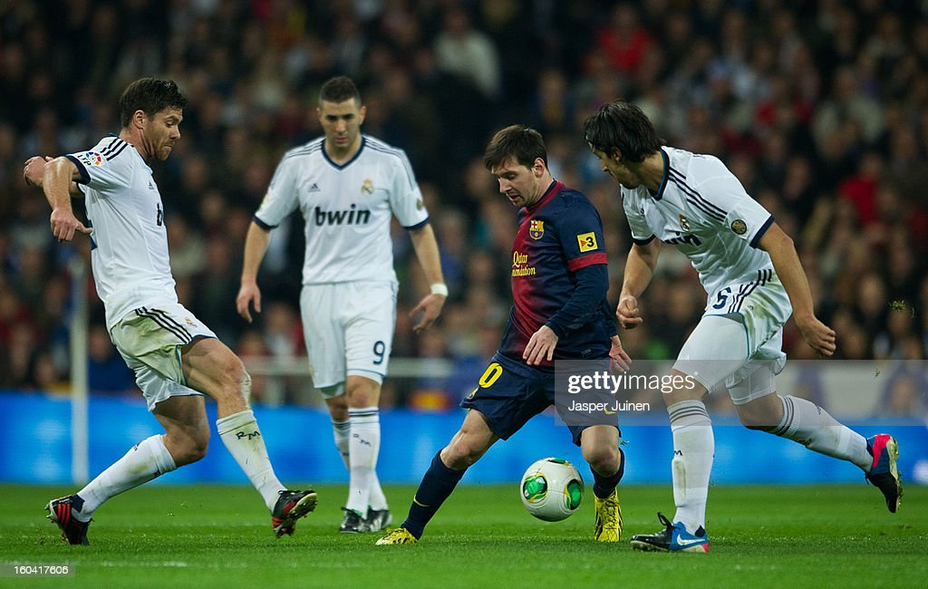 <a gi-track='captionPersonalityLinkClicked' href=/galleries/search?phrase=Lionel+Messi&family=editorial&specificpeople=453305 ng-click='$event.stopPropagation()'>Lionel Messi</a> (2nd R) of Barcelona duels for the ball with <a gi-track='captionPersonalityLinkClicked' href=/galleries/search?phrase=Xabi+Alonso&family=editorial&specificpeople=213833 ng-click='$event.stopPropagation()'>Xabi Alonso</a> and <a gi-track='captionPersonalityLinkClicked' href=/galleries/search?phrase=Sami+Khedira&family=editorial&specificpeople=2513712 ng-click='$event.stopPropagation()'>Sami Khedira</a> of Real Madrid during the Copa del Rey semi final first leg match between Real Madrid CF and FC Barcelona at the Estadio Santiago Bernabeu on January 30, 2013 in Madrid, Spain.