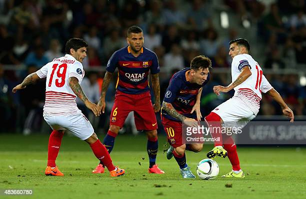 Lionel Messi of Barcelona evades a tackle from Jose Antonio Reyes of Sevilla during the UEFA Super Cup between Barcelona and Sevilla FC at Dinamo...