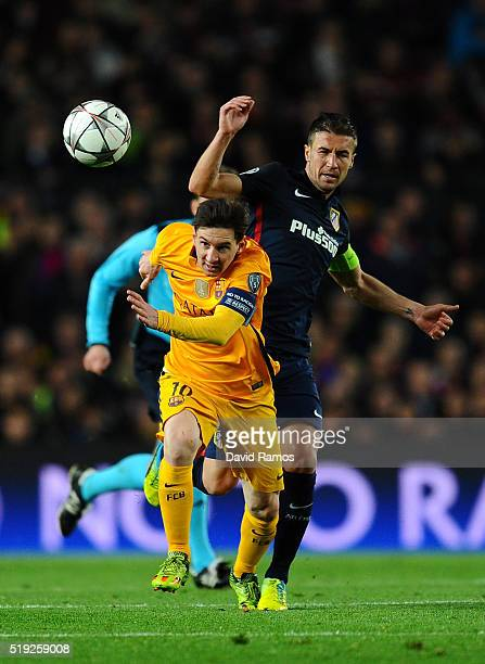 Lionel Messi of Barcelona evades Gabi of Atletico Madrid during the UEFA Champions League quarter final first leg match between FC Barcelona and Club...