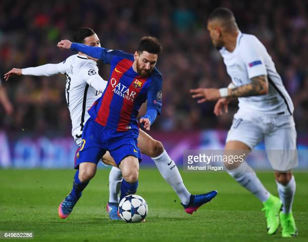 Lionel Messi of Barcelona evades Julian Draxler of PSG during the UEFA Champions League Round of 16 second leg match between FC Barcelona and Paris...