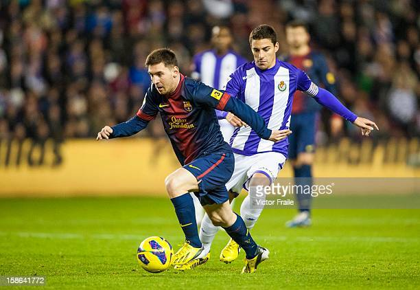 Lionel Messi of Barcelona fights for the ball during the La Liga game between Real Valladolid and FC Barcelona at Jose Zorrilla on December 22 2012...