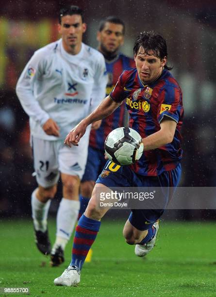 Lionel Messi of Barcelona gets away from Alejandro Alfaro of Tenerife during the La Liga match between Barcelona and Tenerife at Camp Nou stadium on...