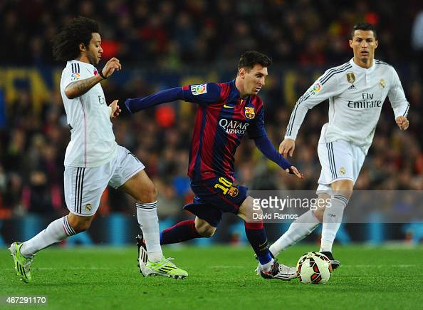 Lionel Messi of Barcelona goes between Marcelo and Cristiano Ronaldo of Real Madrid CF during the La Liga match between FC Barcelona and Real Madrid...