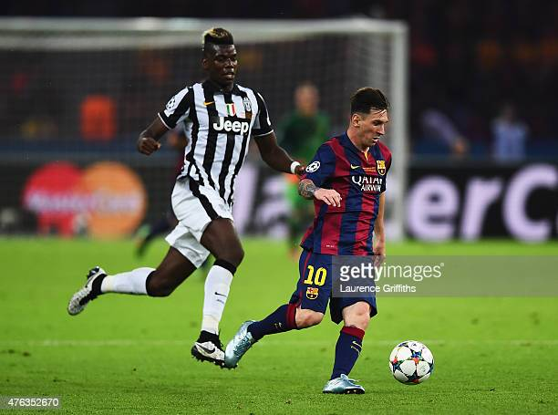 Lionel Messi of Barcelona goes past Paul Pogba of Juventus during the UEFA Champions League Final between Juventus and FC Barcelona at Olympiastadion...