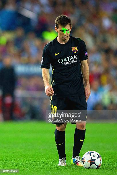 Lionel Messi of Barcelona has a green laser shone on his face during the UEFA Champions League Quarter Final second leg match between Club Atletico...