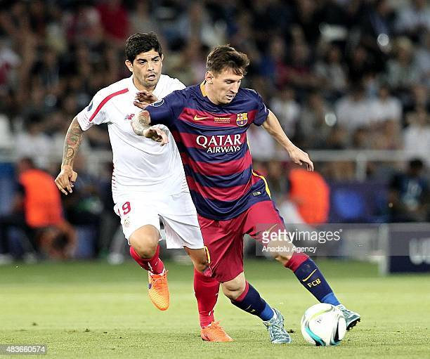 Lionel Messi of Barcelona in action against Ever Banega of Sevilla during the UEFA Super Cup match between Barcelona and Sevilla at Boris Paichadze...