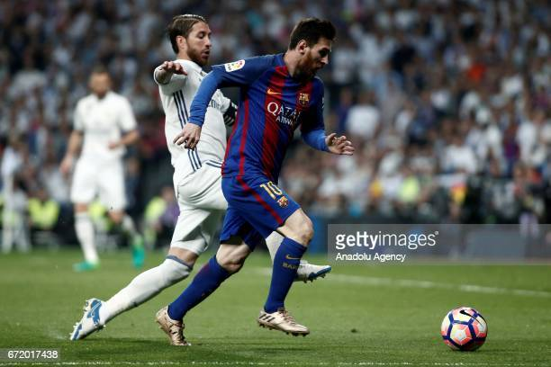 Lionel Messi of Barcelona in action against Sergio Ramos of Real Madrid during the La Liga match between Real Madrid and Barcelona at Santiago...