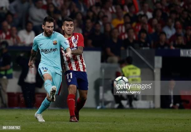Lionel Messi of Barcelona in action against Yannick Carrasco of Atletico Madrid during the Spanish La Liga match between Atletico Madrid and...