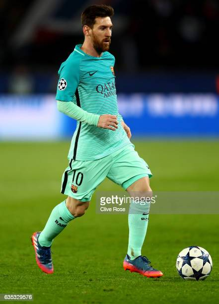Lionel Messi of Barcelona in action during the UEFA Champions League Round of 16 first leg match between Paris SaintGermain and FC Barcelona at Parc...