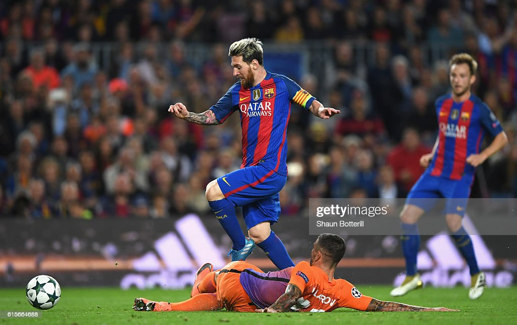 Lionel Messi of Barcelona is bought down in the penalty area by Aleksander Kolorov of Manchester City during the UEFA Champions League group C match between FC Barcelona and Manchester City FC at Camp Nou on October 19, 2016 in Barcelona, Spain.