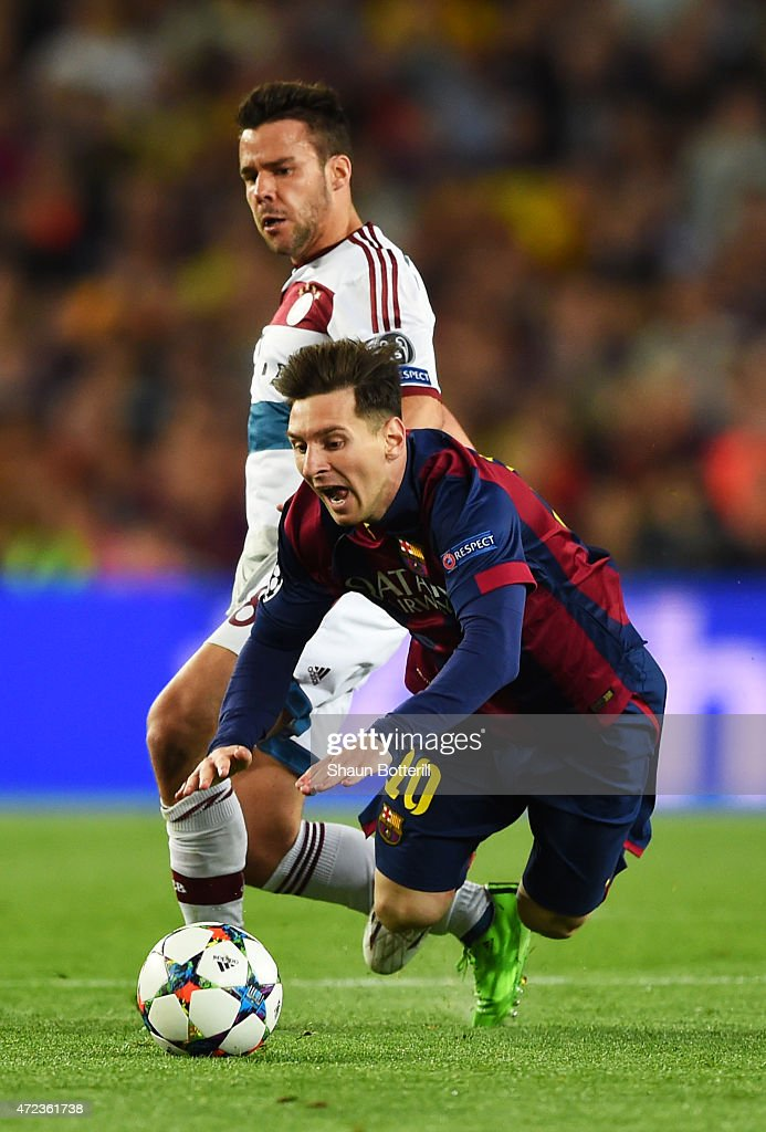 <a gi-track='captionPersonalityLinkClicked' href=/galleries/search?phrase=Lionel+Messi&family=editorial&specificpeople=453305 ng-click='$event.stopPropagation()'>Lionel Messi</a> of Barcelona is brought down by <a gi-track='captionPersonalityLinkClicked' href=/galleries/search?phrase=Juan+Bernat&family=editorial&specificpeople=8821838 ng-click='$event.stopPropagation()'>Juan Bernat</a> of Bayern Muenchen during the UEFA Champions League Semi Final, first leg match between FC Barcelona and FC Bayern Muenchen at Camp Nou on May 6, 2015 in Barcelona, Spain.