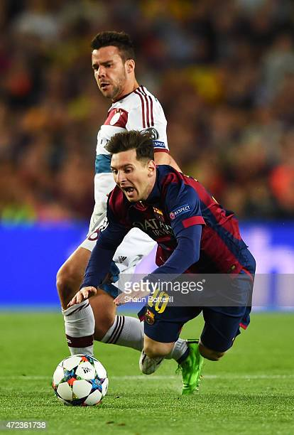 Lionel Messi of Barcelona is brought down by Juan Bernat of Bayern Muenchen during the UEFA Champions League Semi Final first leg match between FC...