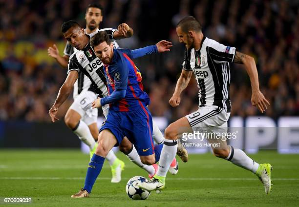 Lionel Messi of Barcelona is challenged by Alex Sandro and Leonardo Bonucci of Juventus during the UEFA Champions League Quarter Final second leg...