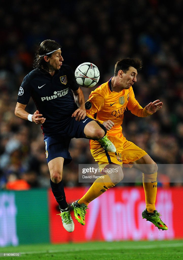 <a gi-track='captionPersonalityLinkClicked' href=/galleries/search?phrase=Lionel+Messi&family=editorial&specificpeople=453305 ng-click='$event.stopPropagation()'>Lionel Messi</a> of Barcelona is challenged by Felipe Luis of Atletico Madrid during the UEFA Champions League quarter final first leg match between FC Barcelona and Club Atletico de Madrid at Camp Nou on April 5, 2016 in Barcelona, Spain.