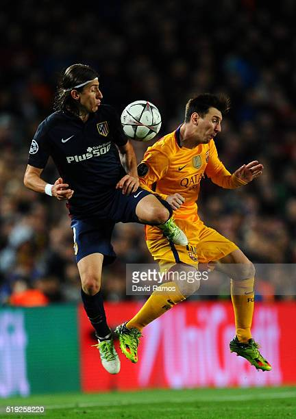 Lionel Messi of Barcelona is challenged by Felipe Luis of Atletico Madrid during the UEFA Champions League quarter final first leg match between FC...