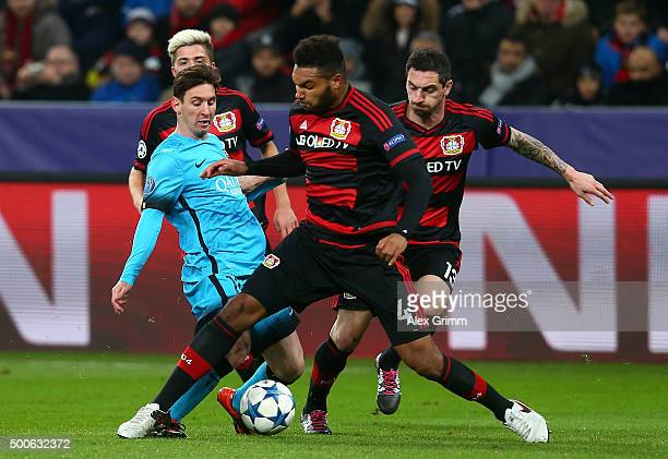 Lionel Messi of Barcelona is challenged by Jonathan Tah of Bayer Levekusen and Roberto Hilbert of Bayer Levekusen during the UEFA Champions League...