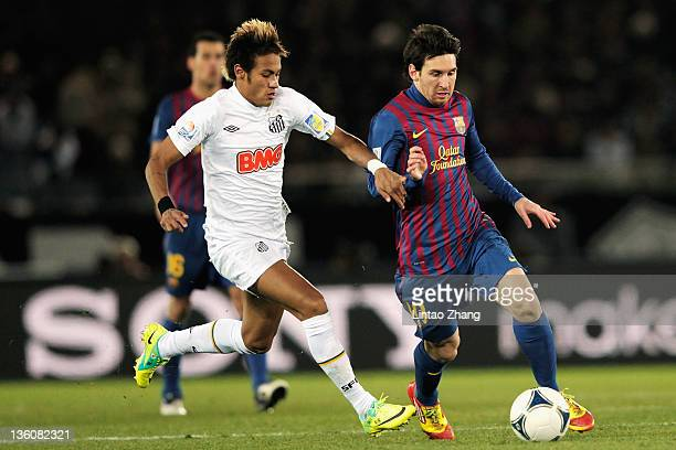 Lionel Messi of Barcelona is challenged by Neymar of Santos during the FIFA Club World Cup Final match between Santosl and Barcelona at the Yokohama...