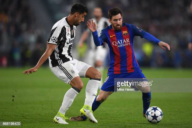 Lionel Messi of Barcelona is challenged by Sami Khedira of Juventus during the UEFA Champions League Quarter Final first leg match between Juventus...