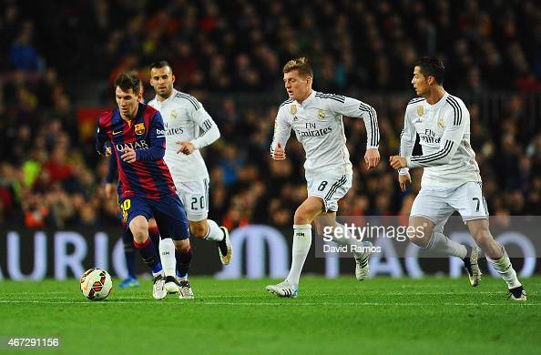 Lionel Messi of Barcelona is chased by Jese Toni Kroos and Cristiano Ronaldo of Real Madrid CF during the La Liga match between FC Barcelona and Real...