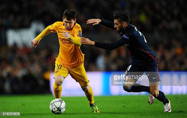 Lionel Messi of Barcelona is chased by Yannick Carrasco of Atletico Madrid during the UEFA Champions League quarter final first leg match between FC...