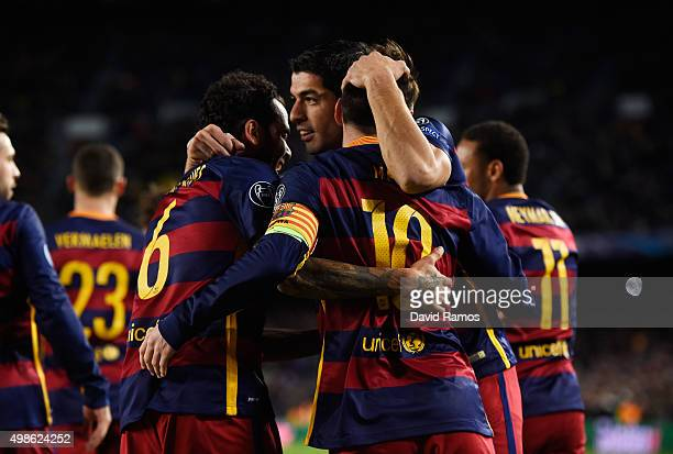 Lionel Messi of Barcelona is congratulated by Luis Suarez and Dani Alves of Barcelona after scoring his teams second goal during the UEFA Champions...