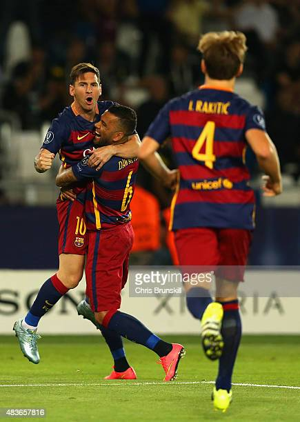 Lionel Messi of Barcelona is congratulated on scoring a goal with Dani Alves of Barcelona during the UEFA Super Cup between Barcelona and Sevilla FC...