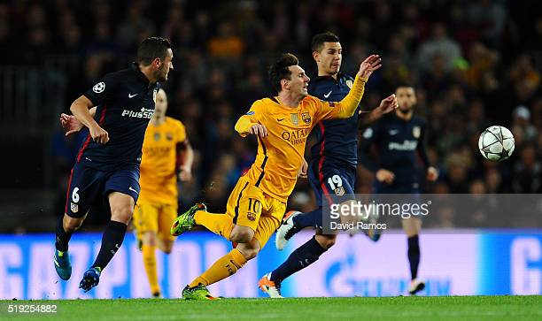 Lionel Messi of Barcelona is foiled by Lucas Hernandez of Atletico Madrid during the UEFA Champions League quarter final first leg match between FC...