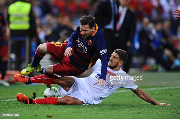 Lionel Messi of Barcelona is foulde by Daniel Carrico of Sevilla during the Copa del Rey Final between Barcelona and Sevilla at Vicente Calderon...