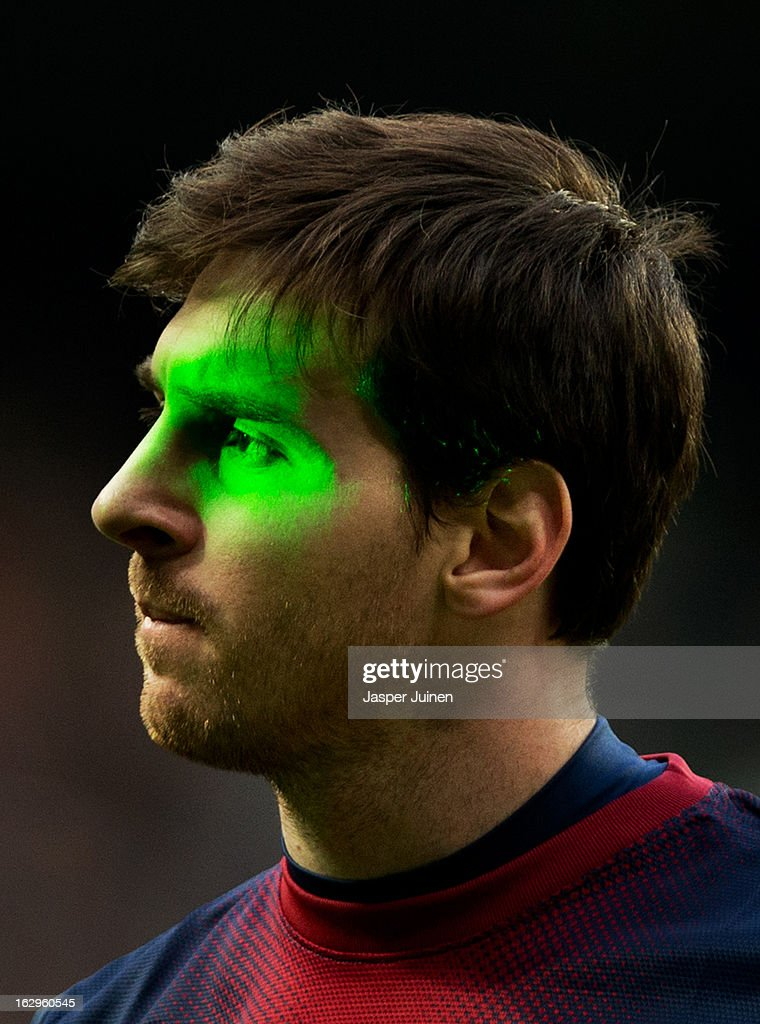 Lionel Messi of Barcelona is illuminated by laser during the la Liga match between Real Madrid CF and FC Barcelona at Estadio Santiago Bernabeu on March 2, 2013 in Madrid, Spain.
