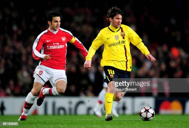 Lionel Messi of Barcelona is pursued by Cesc Fabregas of Arsenal during the UEFA Champions League quarter final first leg match between Arsenal and...