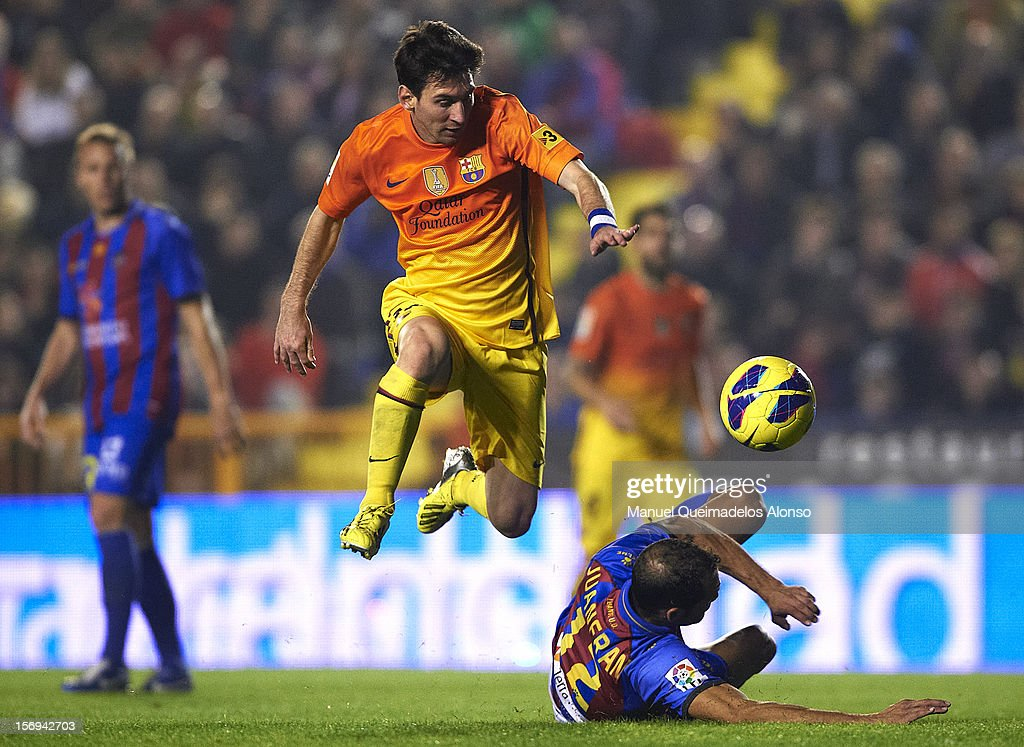 <a gi-track='captionPersonalityLinkClicked' href=/galleries/search?phrase=Lionel+Messi&family=editorial&specificpeople=453305 ng-click='$event.stopPropagation()'>Lionel Messi</a> of Barcelona is tackled by Juanfran of Levante during the la Liga match between Levante UD and FC Barcelona at Ciutat de Valencia on November 25, 2012 in Valencia, Spain.