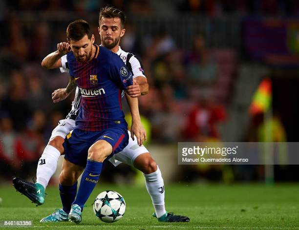 Lionel Messi of Barcelona is tackled by Miralem Pjanic of Juventus during the UEFA Champions League group D match between FC Barcelona and Juventus...