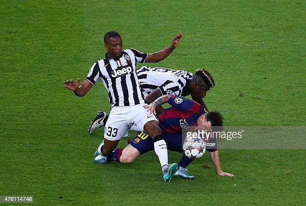Lionel Messi of Barcelona is tackled by Patrice Evra and Paul Pogba of Juventus during the UEFA Champions League Final between Juventus and FC...