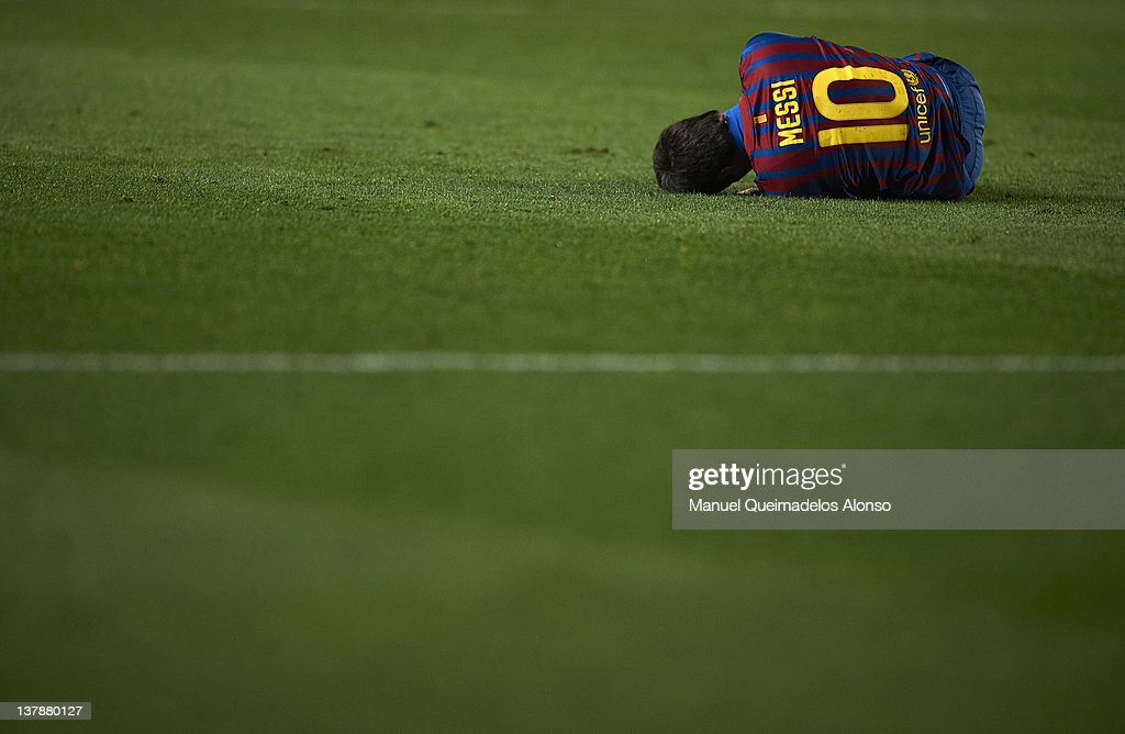 Lionel Messi of Barcelona lays on the pitch during the la Liga match between Villarreal and Barcelona at El Madrigal on January 28, 2012 in Villarreal, Spain.