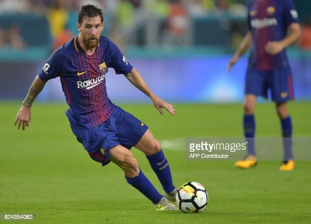Lionel Messi of Barcelona lines up a shot during their International Champions Cup football match against Real Madrid at Hard Rock Stadium on July 29...