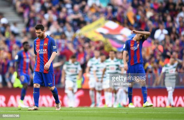 Lionel Messi of Barcelona looks dejected after Eibar score their first goal during the La Liga match between Barcelona and Eibar at Camp Nou on 21...