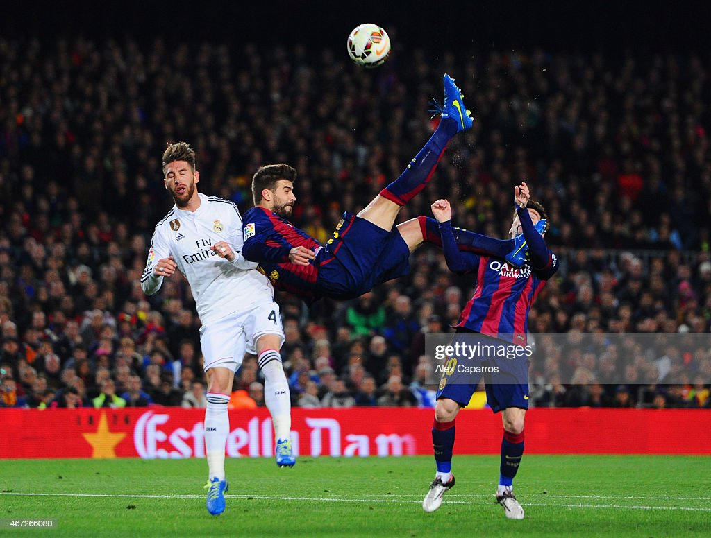 <a gi-track='captionPersonalityLinkClicked' href=/galleries/search?phrase=Lionel+Messi&family=editorial&specificpeople=453305 ng-click='$event.stopPropagation()'>Lionel Messi</a> of Barcelona looks on as <a gi-track='captionPersonalityLinkClicked' href=/galleries/search?phrase=Gerard+Pique&family=editorial&specificpeople=227191 ng-click='$event.stopPropagation()'>Gerard Pique</a> of Barcelona attempts an overhead kick under challenge from Sergio Ramos of Real Madrid CF during the La Liga match between FC Barcelona and Real Madrid CF at Camp Nou on March 22, 2015 in Barcelona, Spain.