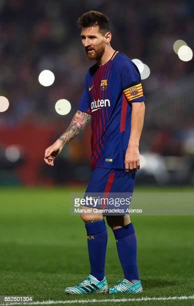 Lionel Messi of Barcelona looks on during the La Liga match between Girona and Barcelona at Municipal de Montilivi Stadium on September 23 2017 in...